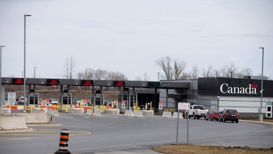 Cars drive through Canadian customs after movement restrictions came into effect due to coronavirus disease in the border town of Cornwall, Ontario, in this file photo.