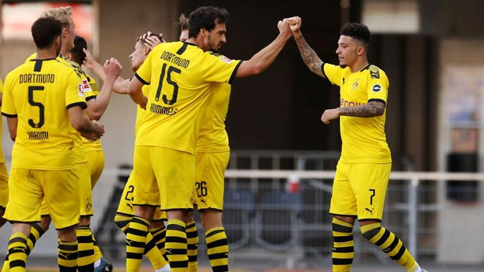 Borussia Dortmund's Jadon Sancho celebrates scoring their third goal with teammates, as play resumes behind closed doors following the outbreak of the coronavirus disease (COVID-19) Lars Baron/Pool via REUTERS