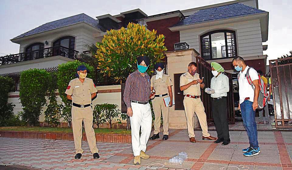 Police officials at the spot in Sector 33-C, Chandigarh on Sunday. The masked shooters were caught in the CCTV footage.