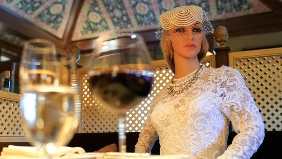 FILE PHOTO: To ensure social distancing does not make diners feel isolated during the coronavirus disease (COVID-19) outbreak, mannequins clad in 1940s-era clothing occupy some tables at The Inn at Little Washington, a Michelin three-star restaurant, which plans to reopen soon in Washington, Virginia, U.S., May 20, 2020. REUTERS/Kevin Lamarque (Reuters)