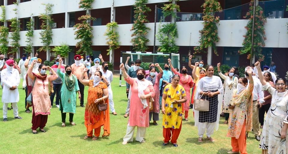 Parents protesting on Monday outside Guru Nanak Public School (GNPS), Model Town Extension, Ludhiana, against the transfer of their children here from GNPS Birmi.