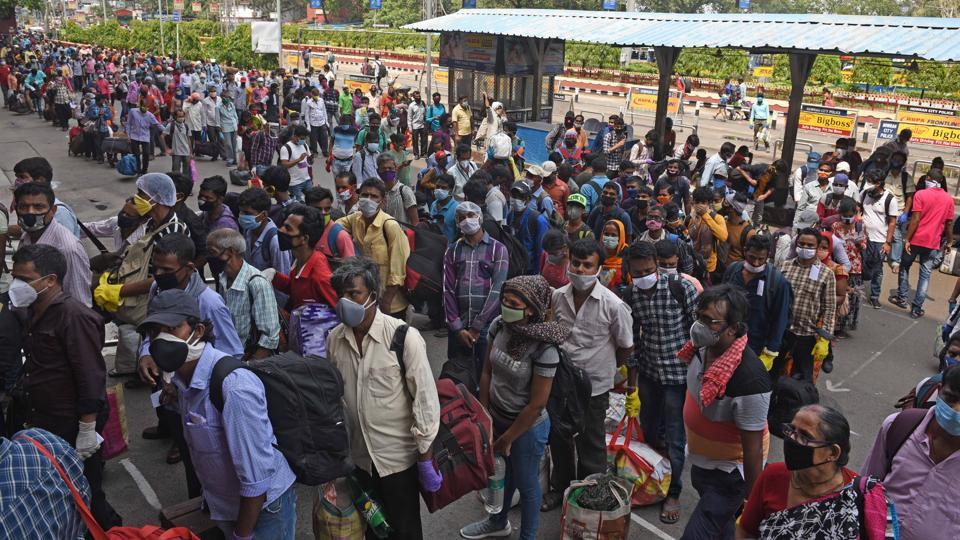 Commuters waiting  to enter Howrah Station and flouting social distancing norms after lockdown restrictions were eased in Kolkata on Monday.