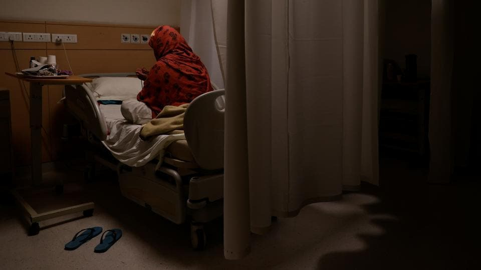 "A patient suffering from the coronavirus disease (COVID-19) prays while in the emergency ward of Max Smart Super Speciality Hospital. ""Manpower will be the biggest challenge. We have reached the limit,"" Dr. Dewan said, adding even as the toll rises, the wait list of patients is growing fast. (Danish Siddiqui / REUTERS)"