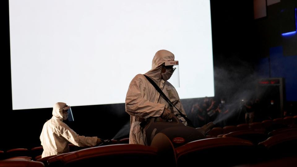 Workers wearing protective suits spray disinfectant inside a movie theater ahead of its reopening after the Thai government eased isolation measures to prevent the spread of the coronavirus disease (COVID-19) in Bangkok, Thailand, June 1, 2020. (Representational)