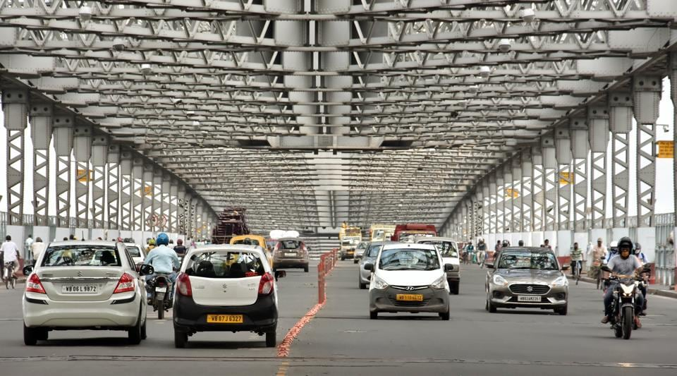 Vehicles ply on a Howrah Bridge during the nationwide lockdown 5 imposed in the wake Covid-19 pandemic in Kolkata on Monday.