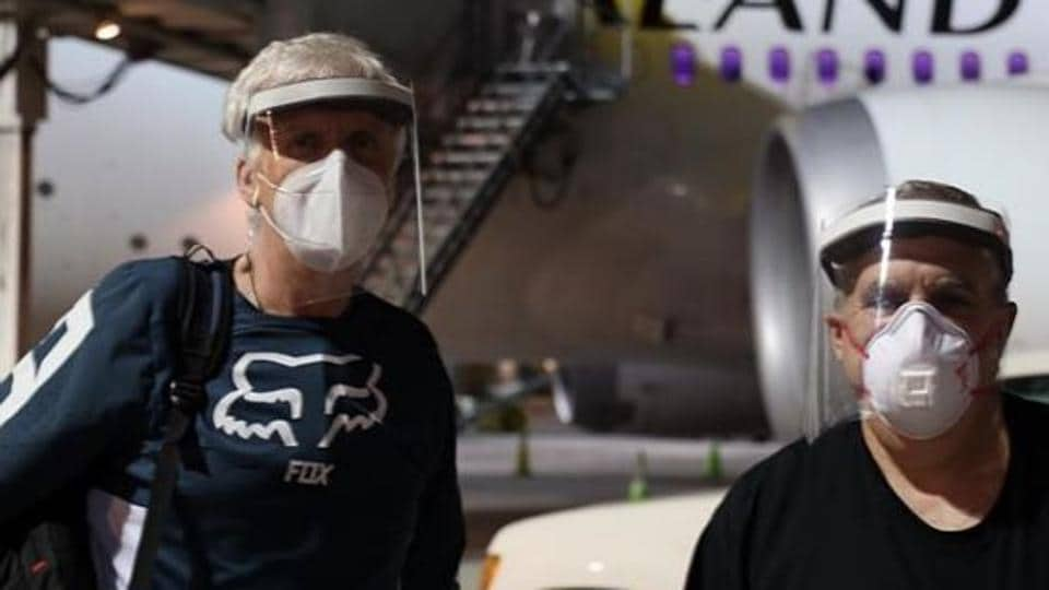 James Cameron and Jon Landau upon their return to New Zealand.