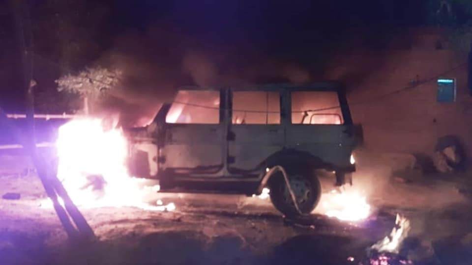 A police jeep is seen on fire after violence in a village in Uttar Pradesh's Pratapgarh district on Monday. The violence erupted after a 25-year-old man burnt alive by the family of a woman he was allegedly having an affair.