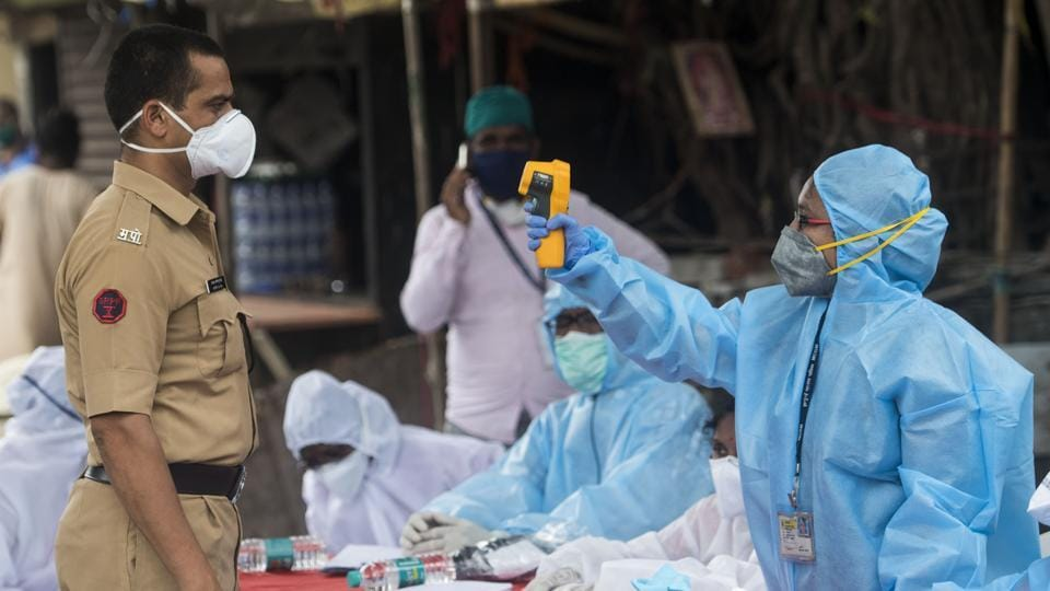 Health workers conducting Covid-19 testing drive at Dharavi slum in Mumbai, on Monday.
