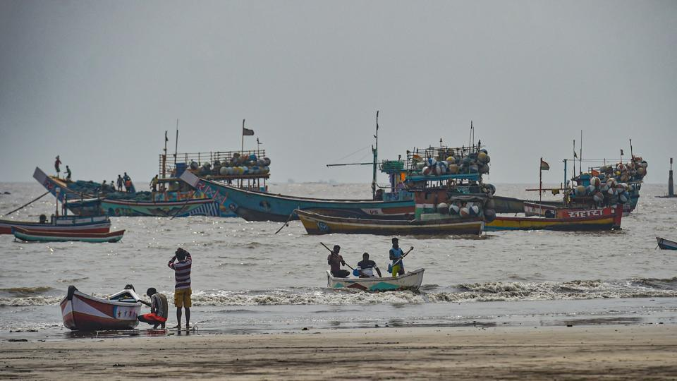 Fishing boats seen anchored at a shore following a warning by Indian Meteorological Department (IMD) for fishermen not to enter the Arabian Sea for the next two days as a precaution against cyclone 'Nisarga'.