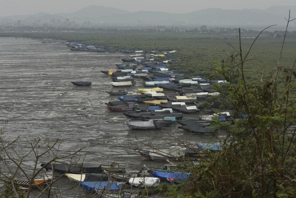 Fisherman parked their boats at the bay in Bhayandar as Cyclone Nisarga is about to hit the western shore in Mumbai on Tuesday.
