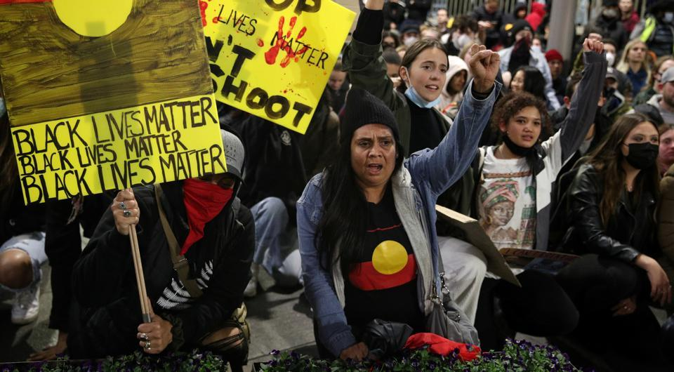 People protest in solidarity with those in the United States protesting police brutality and the death in Minneapolis police custody of George Floyd, in Sydney, Australia, June 2, 2020. REUTERS/Loren Elliott