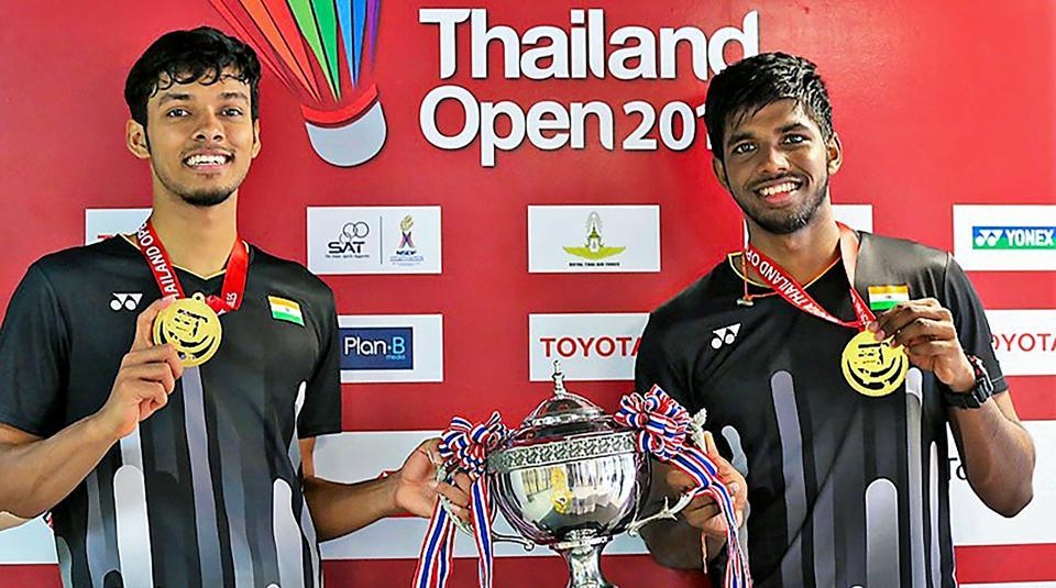 India's Satwiksairaj Rankireddy and Chirag Shetty pose with their medals and trophy after winning the Thailand Open 2019 badminton doubles title in Bangkok.