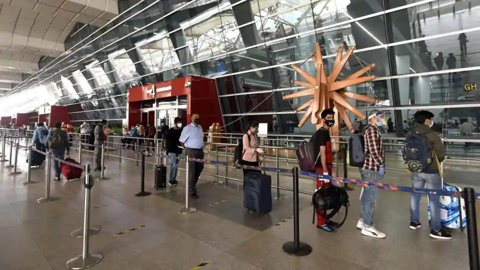 Passengers queue to get their documents verified before entering the IGI Airport amid the lockdown, in New Delhi, India, on Saturday, May 30, 2020.
