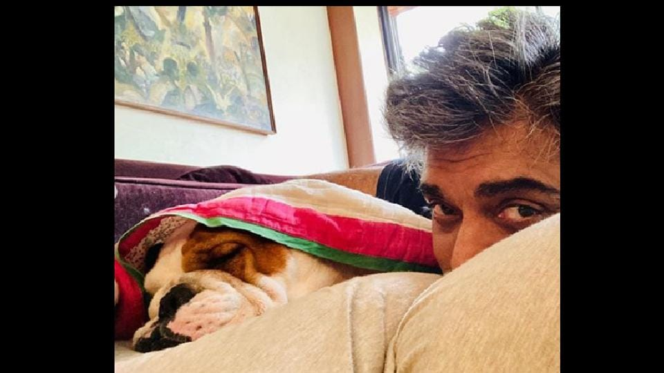 This photo of Ram Kapoor and Popeye is so cute that you'll want a nap and naptime partner just like him.