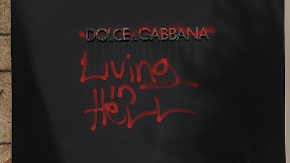 A Dolce & Gabbana Srl store, defaced with graffiti reading
