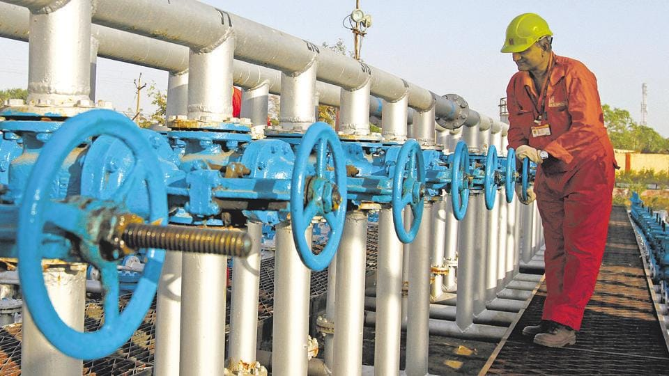 A technician opens a pressure gas valve inside the Oil and Natural Gas Corp (ONGC) group gathering station on the outskirts of the western Indian city of Ahmedabad.