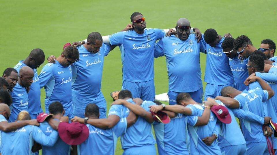 West Indies' Jason Holder, center, and team members huddle during a training session ahead of their first Twenty20 cricket match against India, in Hyderabad.