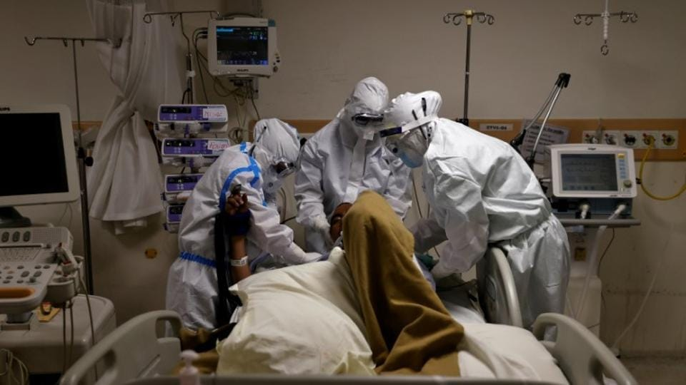 Coronavirus in India: Medical workers wearing personal protective equipment (PPE) take care of a patient suffering from the coronavirus disease (COVID-19), at the Intensive Care Unit (ICU) of the Max Smart Super Speciality Hospital in New Delhi. (Photo:Reuters)