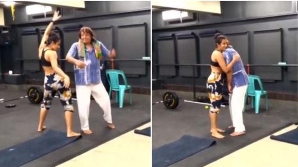 Ranjeet dancing with his daughter.