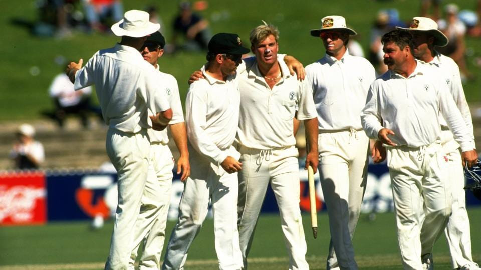 Allan Border of Australia congratulates team mate Shane Warne after the Third Test match against South Africa at the Adelaide Oval in Australia. Australia won the match by 191 runs. \ Mandatory Credit: Allsport UK /Allsport