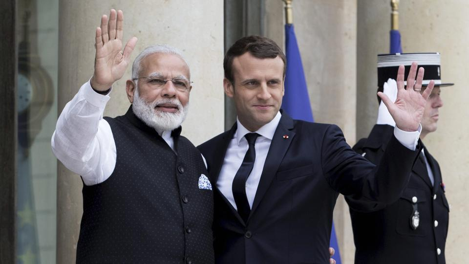 French President Emmanuel Macron, with Prime Minister Narendra Modi, in Paris in this 2017 file photo.