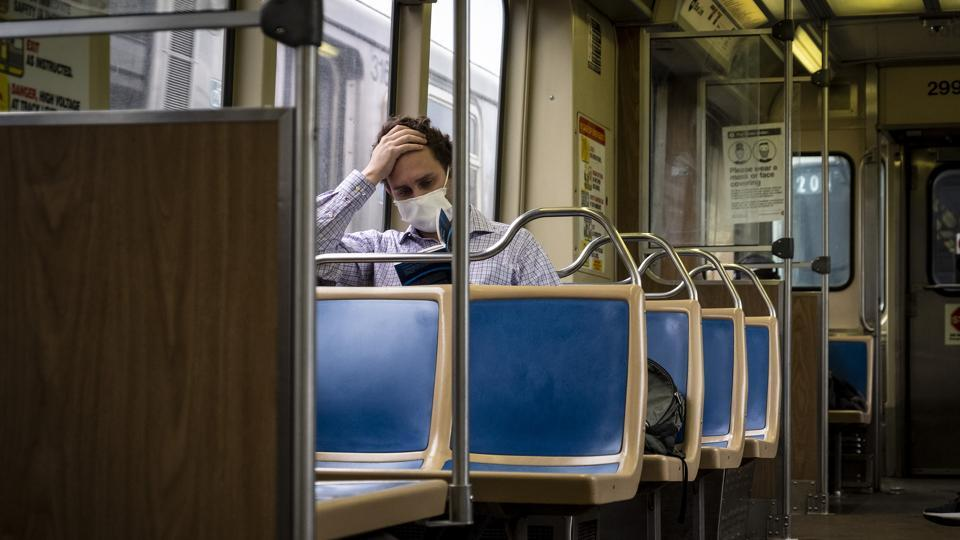 A commuter wearing a protective mask rides a Chicago Transit Authority (CTA) train in Chicago, Illinois, US on Wednesday.