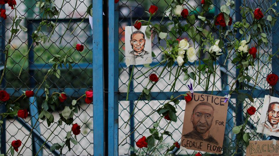 Pictures depicting George Floyd, who died in Minneapolis police custody, are seen next to messages, and flowers as a symbol of a protest against his killing, outside the US embassy in Mexico City.