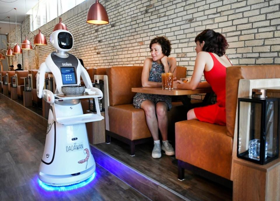 A robot serves in a Chinese restaurant to reduce the risk of spreading the coronavirus disease (COVID-19) in Maastricht, Netherlands.