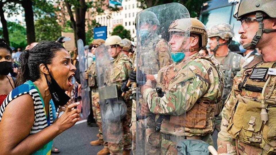 Protester  screams at army personnel near the White House.