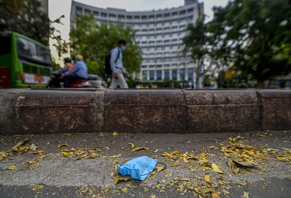 An improperly disposed off mask lies on a pavement in front of The Park hotel, during the nationwide lockdown imposed in wake of the coronavirus pandemic, in New Delhi.