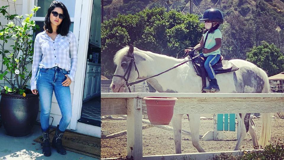 Sunny Leone's daughter Nisha rides a horse.