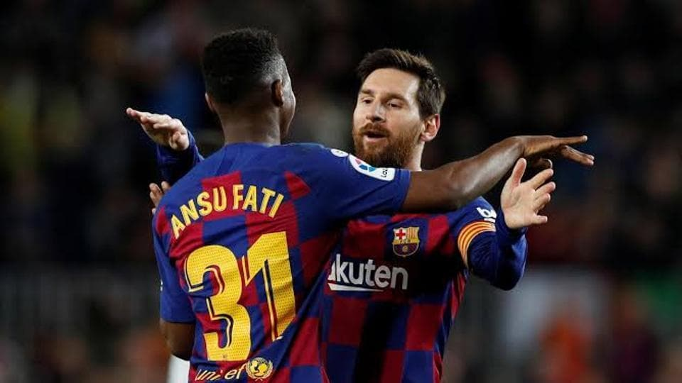 Messi celebrates with Ansu Fati