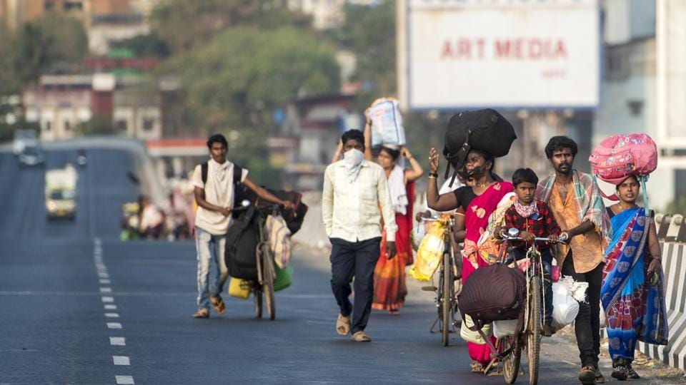 Mumbai, India - April 19, 2020: Migrant workers walk on the WEH at Bhayander with their families as they return to their villages, during nationwide lockdown to lift the spreading of coronavirus in Mumbai, India, on Sunday, April 19, 2020. (Photo by Satyabrata Tripathy/Hindustan Times)