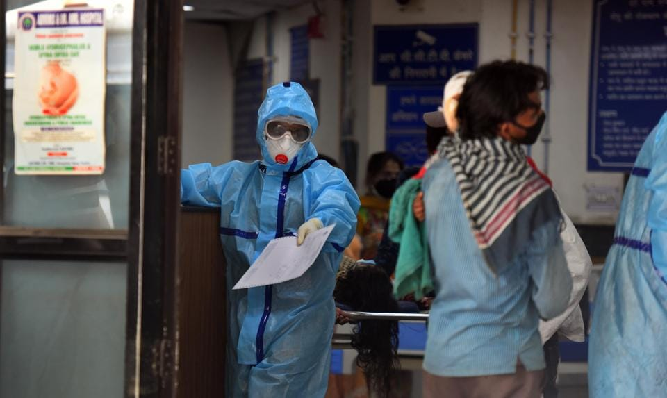 A medical professional seen wearing PPE as a precautionary measure while interacting with patients in Ram Manohar Lohia hospital, New Delhi, India, on Saturday, June 6, 2020.