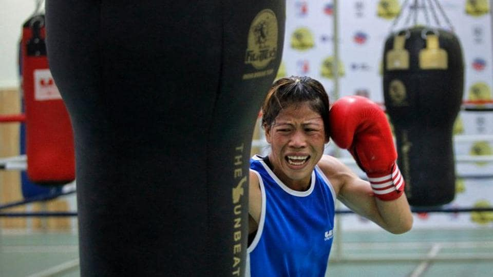MC Mary Kom punches a bag during a training session at Balewadi Stadium in Pune.