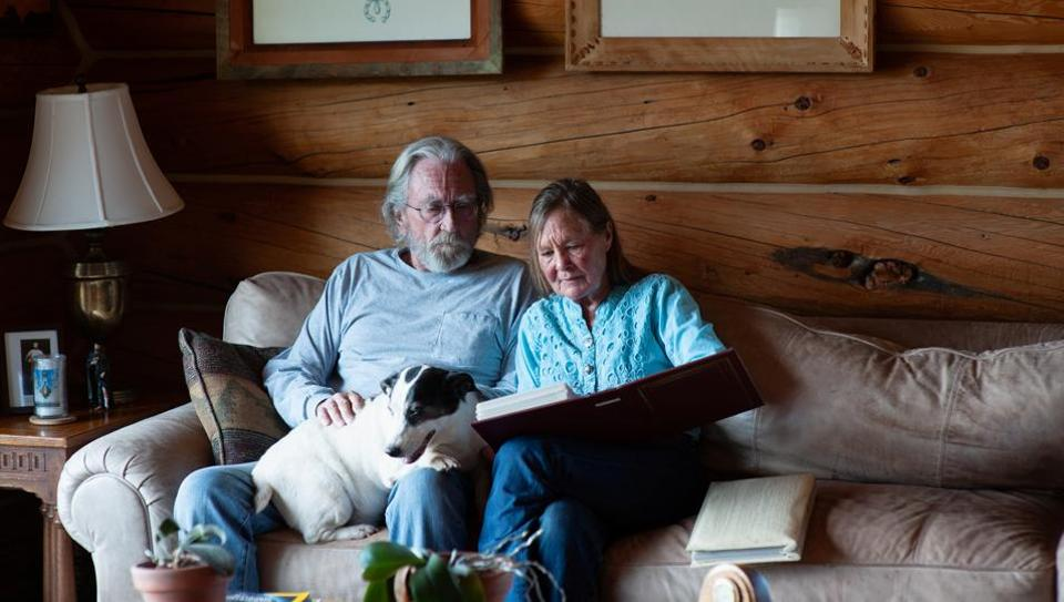 Wendell and Mariann Hardy look through a photo album at their home in Catron County, New Mexico, U.S., April 28 2020. Picture taken April 28, 2020. REUTERS/Amy Haskell