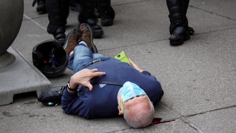 Martin Gugino, a 75-year-old protester, lays on the ground after he was shoved by two Buffalo, New York, police officers during a protest against the death in Minneapolis police custody of George Floyd in Niagara Square in Buffalo, New York.