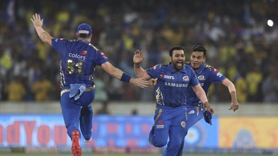 Mumbai Indians captain Rohit Sharma, second right, and teammates celebrate their win in the VIVO IPL T20.