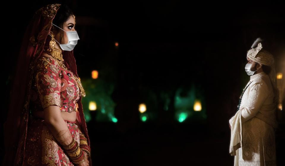 Mask has become an essential at lockdown weddings