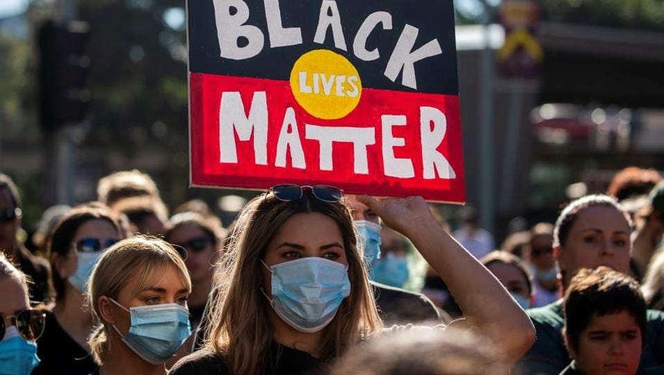 Protesters participate in the Black Lives Matter rally in Brisbane, Australia.
