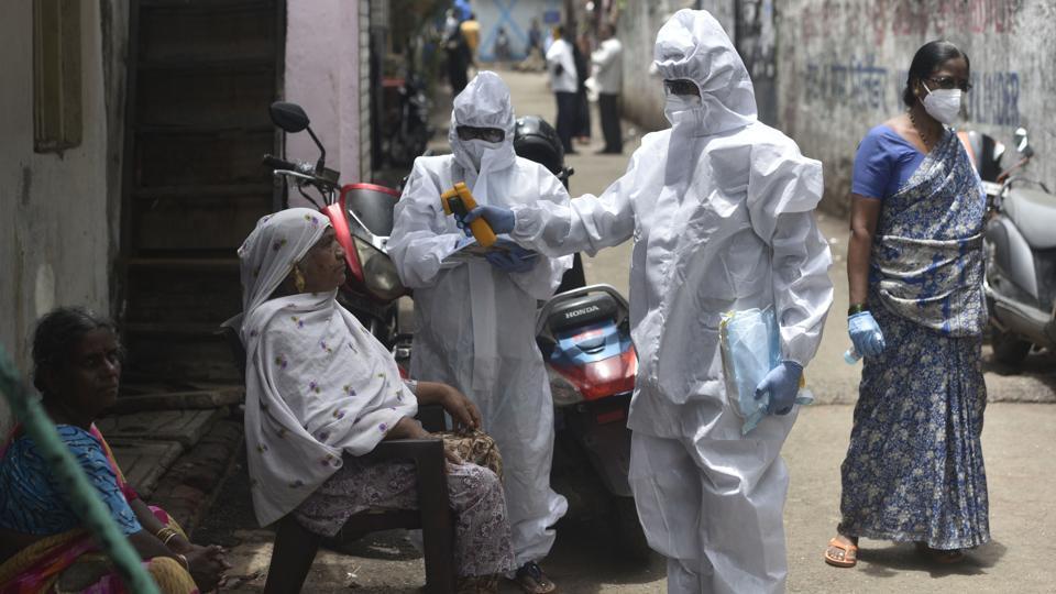 Health workers conducting Covid-19 testing drive inside Mumbai's Dharavi slum on Monday.