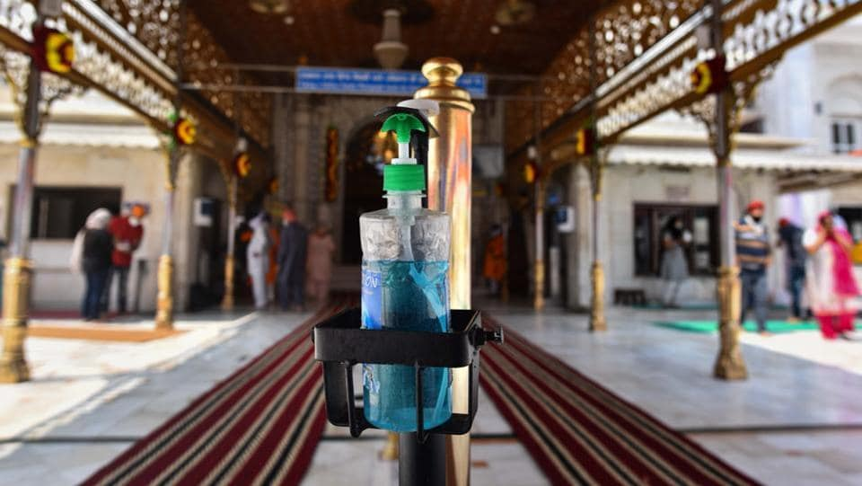 A hand sanitizer dispenser installed in Gurudwara Bangla Sahib after it reopened to the public for the first time since the nationwide lockdown was imposed to curb the spread of coronavirus, near Connaught Place in New Delhi on Monday.