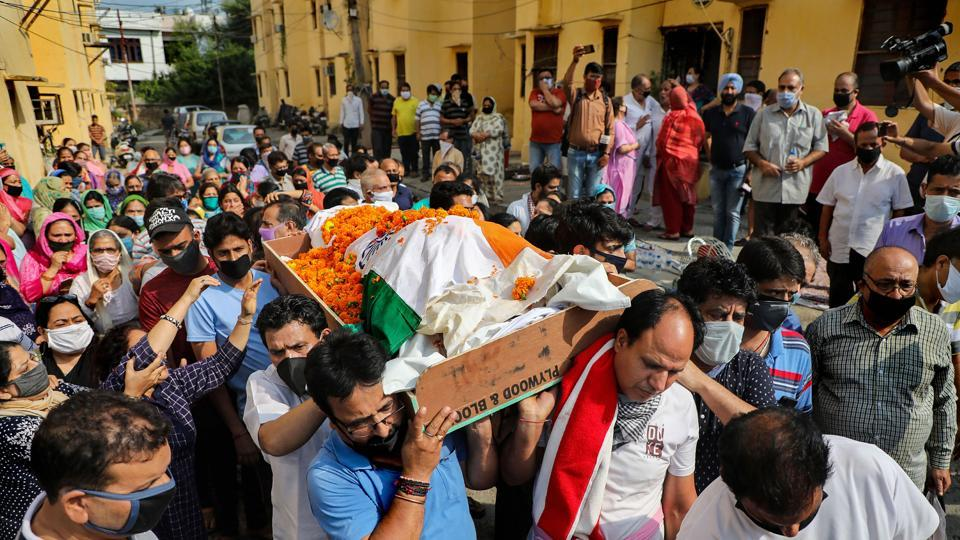 The mortal remains of Kashmiri Pandit sarpanch Ajay Pandita being carried for cremation  in Jammu on  Tuesday.