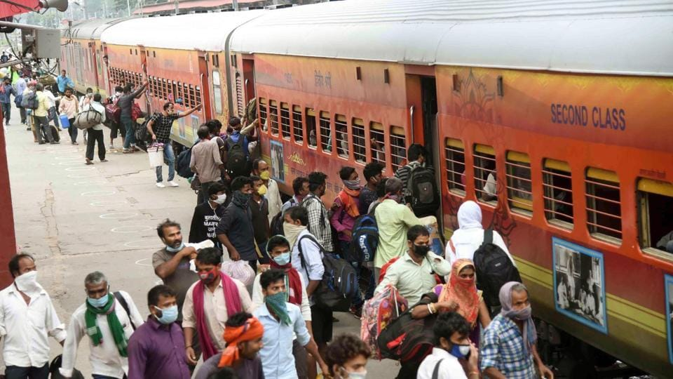 Migrants arrive from Delhi on a Shramik Special board a local train at Danapur station to reach their destinations in Patna, Bihar.