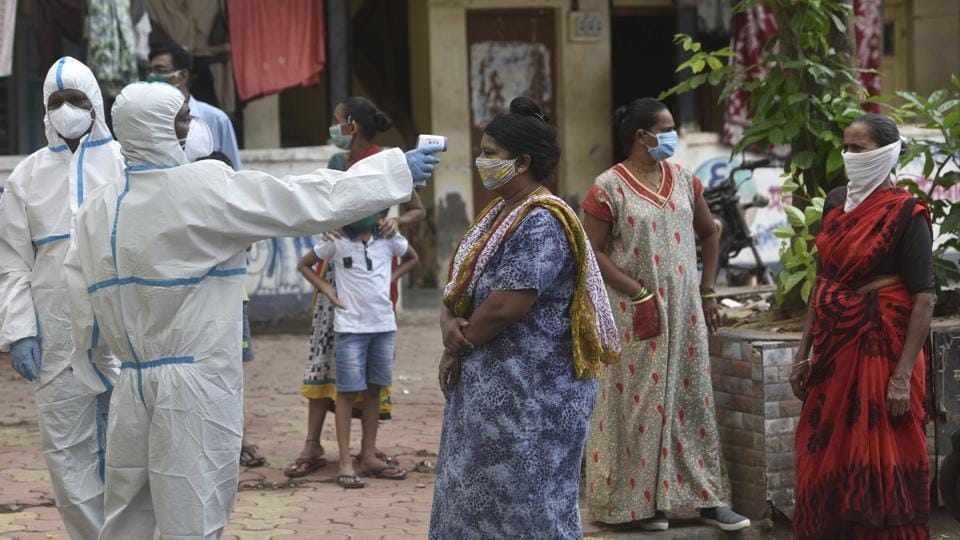 Health workers conduct Covid-19 test at a labour camp, in Mumbai's Matunga on Tuesday.