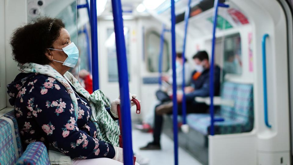 A woman wearing a protective face mask is seen on a London Underground train, following the outbreak of the coronavirus disease (COVID-19), London, Britain, June 10, 2020.