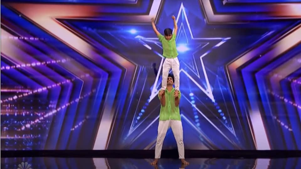 The image shows the two performers on America's Got Talent's stage.