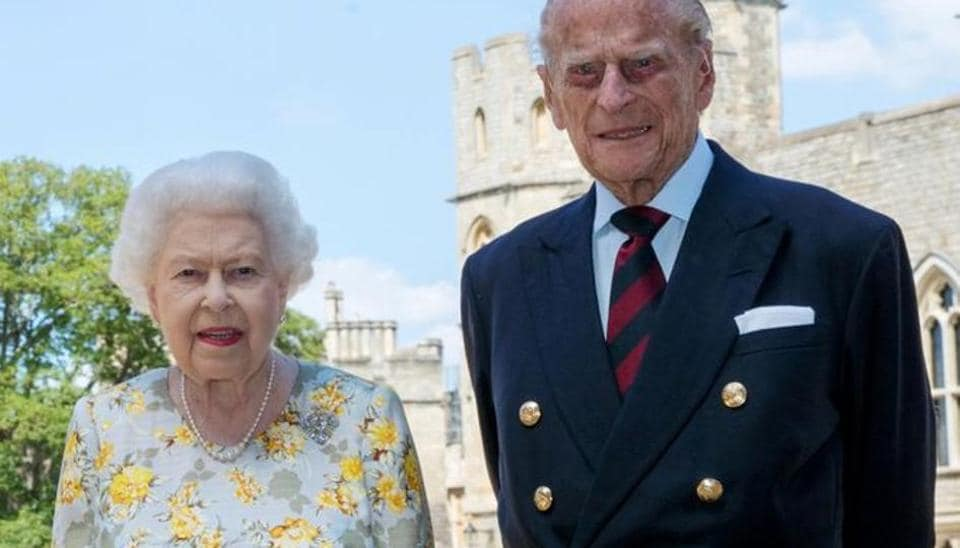 Britain's Queen Elizabeth II and Britain's Prince Philip, Duke of Edinburgh, poses in the quadrangle of Windsor Castle ahead of his 99th birthday on June 6, 2020. Steve Parsons/PA Wire/Pool via REUTERS