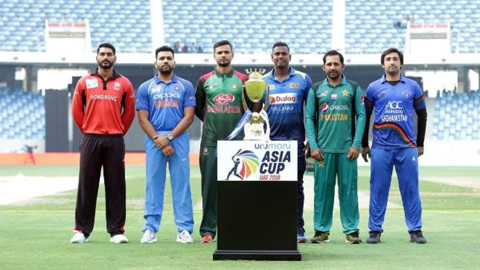 Captains posing with the Asia Cup in 2018.