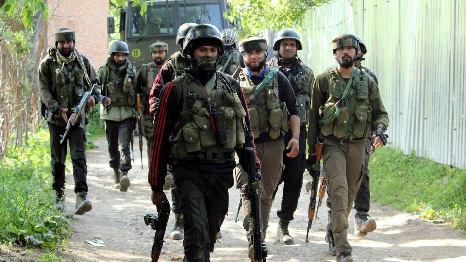 Army jawans approaching an encounter site in the Pinjora area of Shopian in south Kashmir.